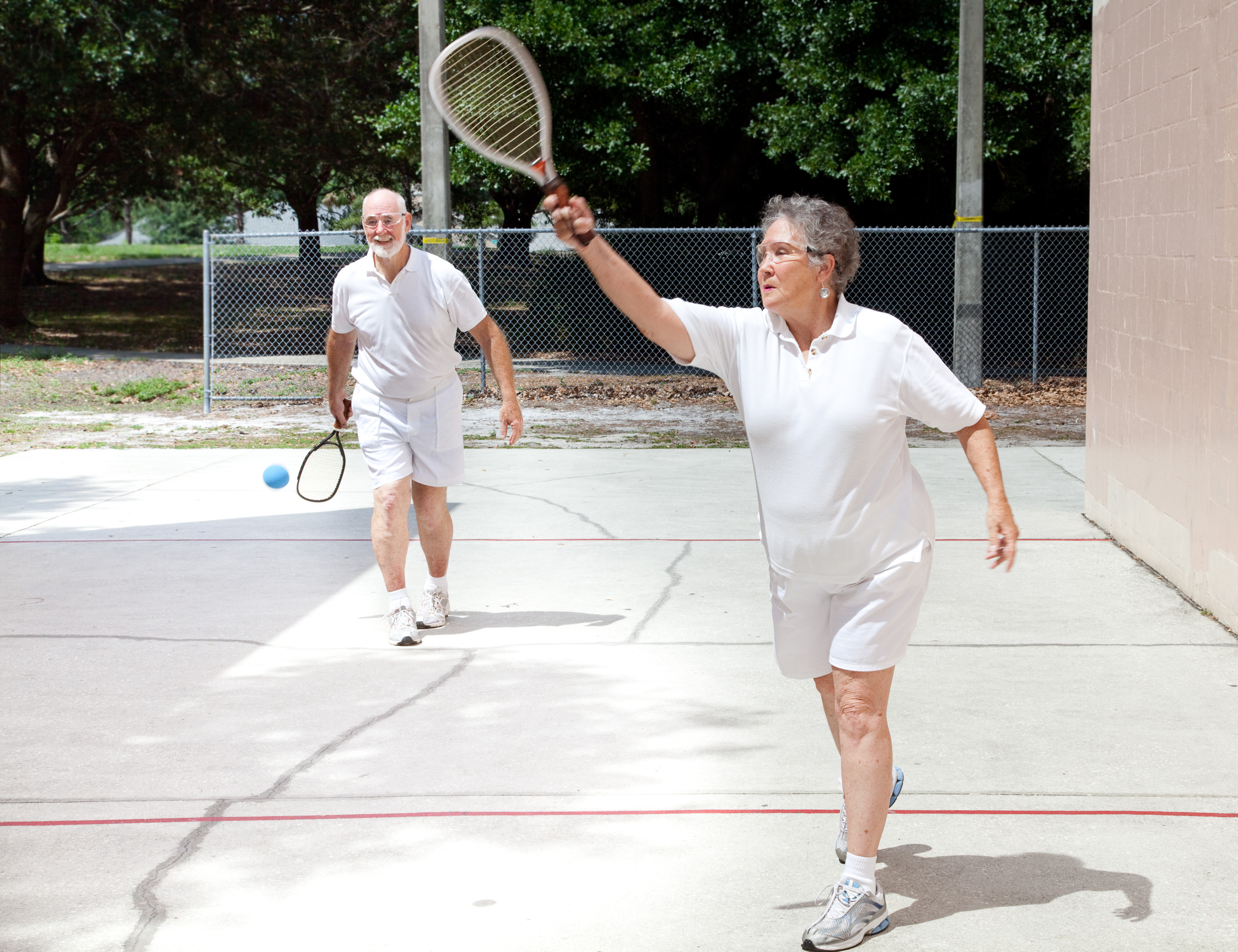 Older adults playing racquetball